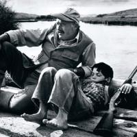 Robert Capa.novelist Ernest Hemingway and his son Gregory